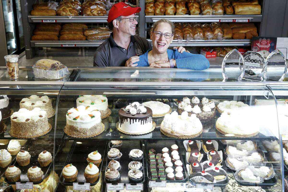 Three Brothers Bakery owners Bobby and Janice Jucker stand for a portrait at their South Braeswood bakery that has flooded multiple times over the last decade and last year was inundated by four and a half feet of water during Hurricane Harvey.