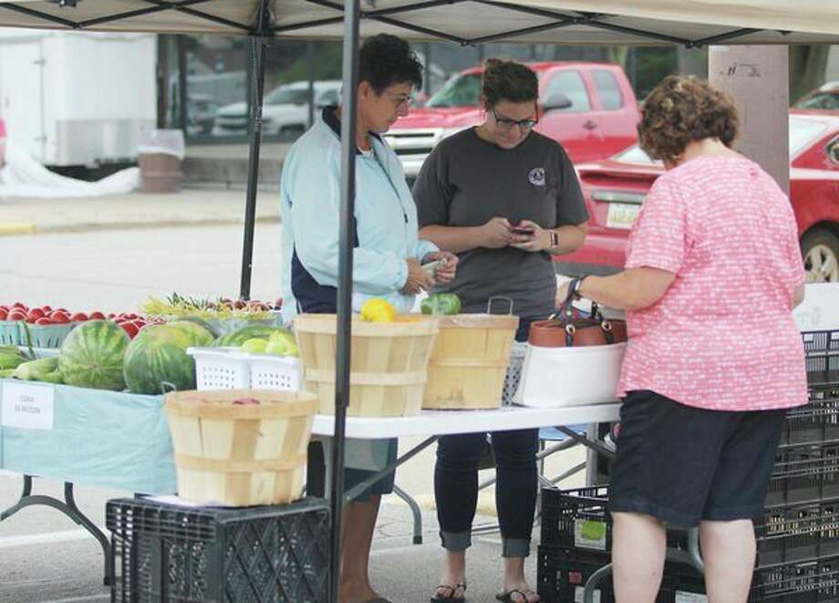 Vendors set up at the Sebewaing Country Market and Music Fest Saturday. While the band, Southern Breeze, was unable to perform due to the weather, around 20 vendors set up in downtown Sebewaing. There was also a Slow-Pitch Softball Tournament held. (Mike Gallagher/Huron Daily Tribune)