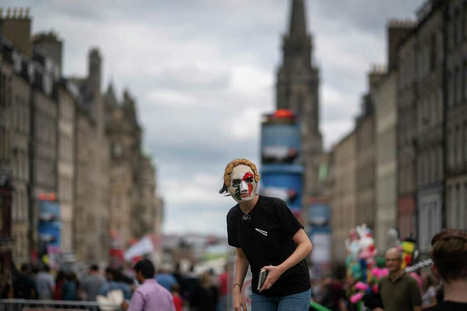 Edinburgh Festival Fringe entertainers perform and promote their shows on the Royal Mile on Aug. 2, 2018, in Edinburgh, Scotland. The Edinburgh Fringe Festival is the largest performing arts festival in the world, with an excess of 30,000 performances of more than 2,000 shows. Photo: Christopher Furlong, Staff / Getty Images / 2018 Getty Images