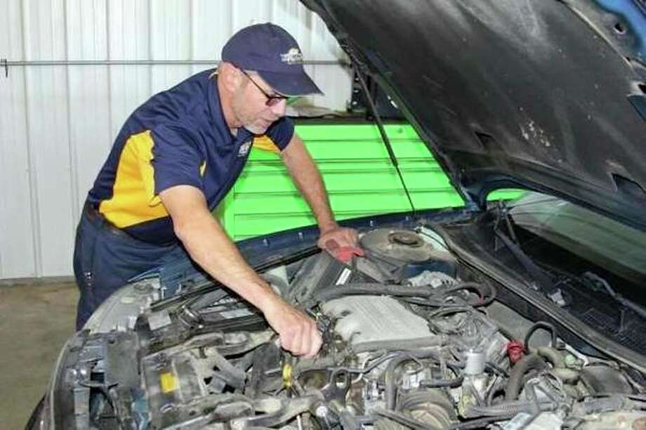 Dave Ney works under the hood at Wolverine Auto. (Wolverine Auto Brokers Facebook)