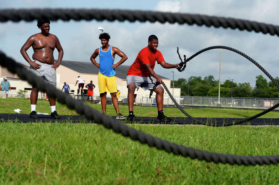 Beaumont United players do rope swings during the football team's summer workouts.  Photo taken Wednesday 7/18/18 Ryan Pelham/The Enterprise Photo: Ryan Pelham/The Enterprise / ?2018 The Beaumont Enterprise