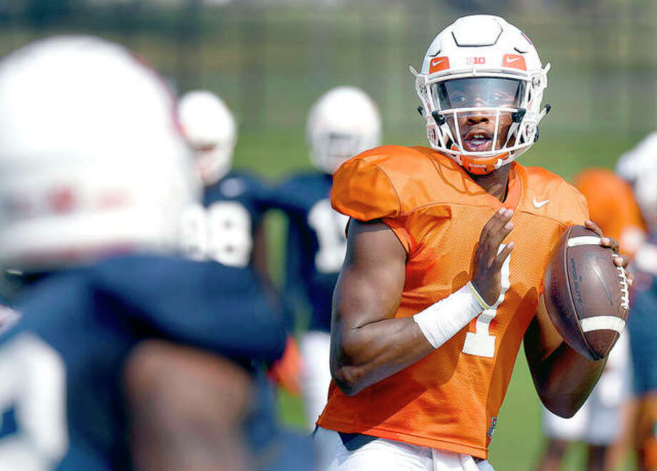 Senior transfer AJ Bush has been named as the Illini starting quarterback by coach Lovie Smith. Bush beat out last year's starter and a promising three-star freshman recruit. Above, Bushg throws during training camp. The Illini open Saturday at home against Kent State. Photo: AP