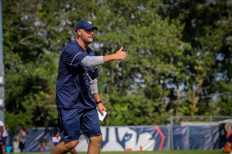 UConn players players believe the teaching ability of new offensive coordinator John Dunn has been a real asset to the program. Photo: UConn Athletics