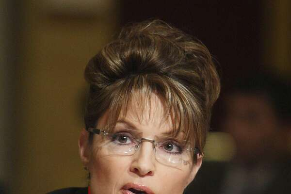 FILE - In this Feb. 24, 2008 file photo, Alaska Gov. Sarah Palin speaks in Washington. The Alaska hair salon made famous for Sarah Palin's up-do is getting the reality show treatment in a two-part series to be aired in September on TLC. (AP Photo/Charles Dharapak, File)