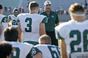 Southwest head coach Matt Elliott talks with players after their Class 6A Division I second-round playoff game against   Los Fresnos held Saturday Nov. 25, 2017 at Alamo Stadium. Los Fresnos won 47-35.