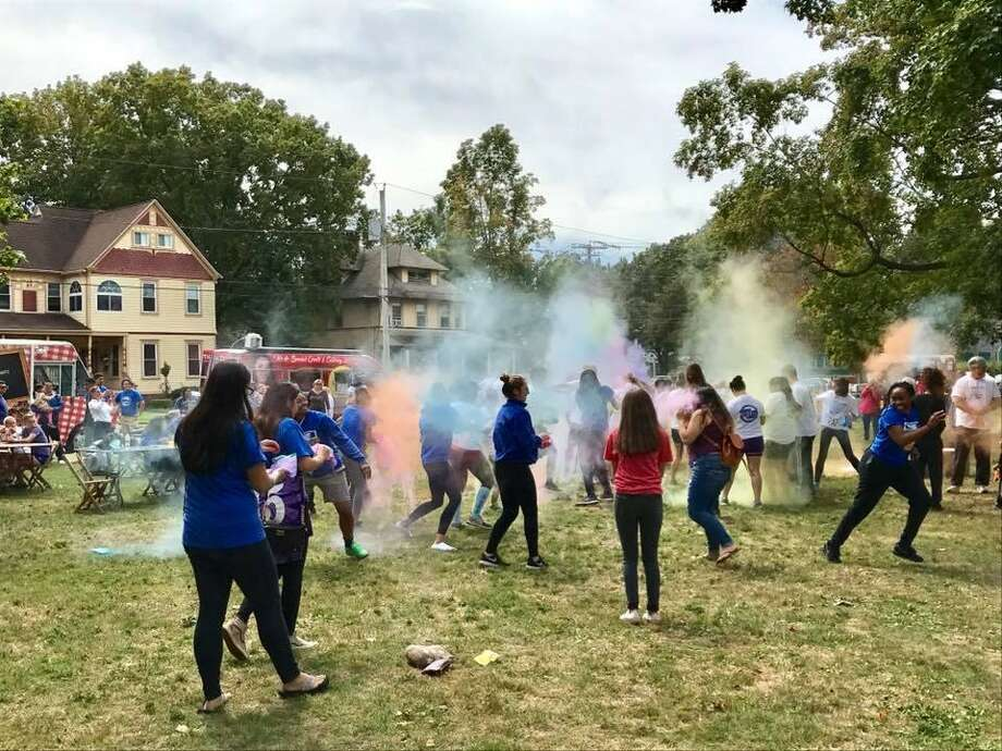 "A ""color party"" takes place on the West Haven at the 2017 WestFest. WestFest 2018, will return on Saturday, Sept. 8 from 11 a.m. to 6 p.m., featuring food, music and inflatable playscapes for the fourth straight year.The free event is a community festival aimed at bringing the West Haven and University of New Haven communities closer. The rain date is Sunday, Sept. 9. Photo: Contributed /"