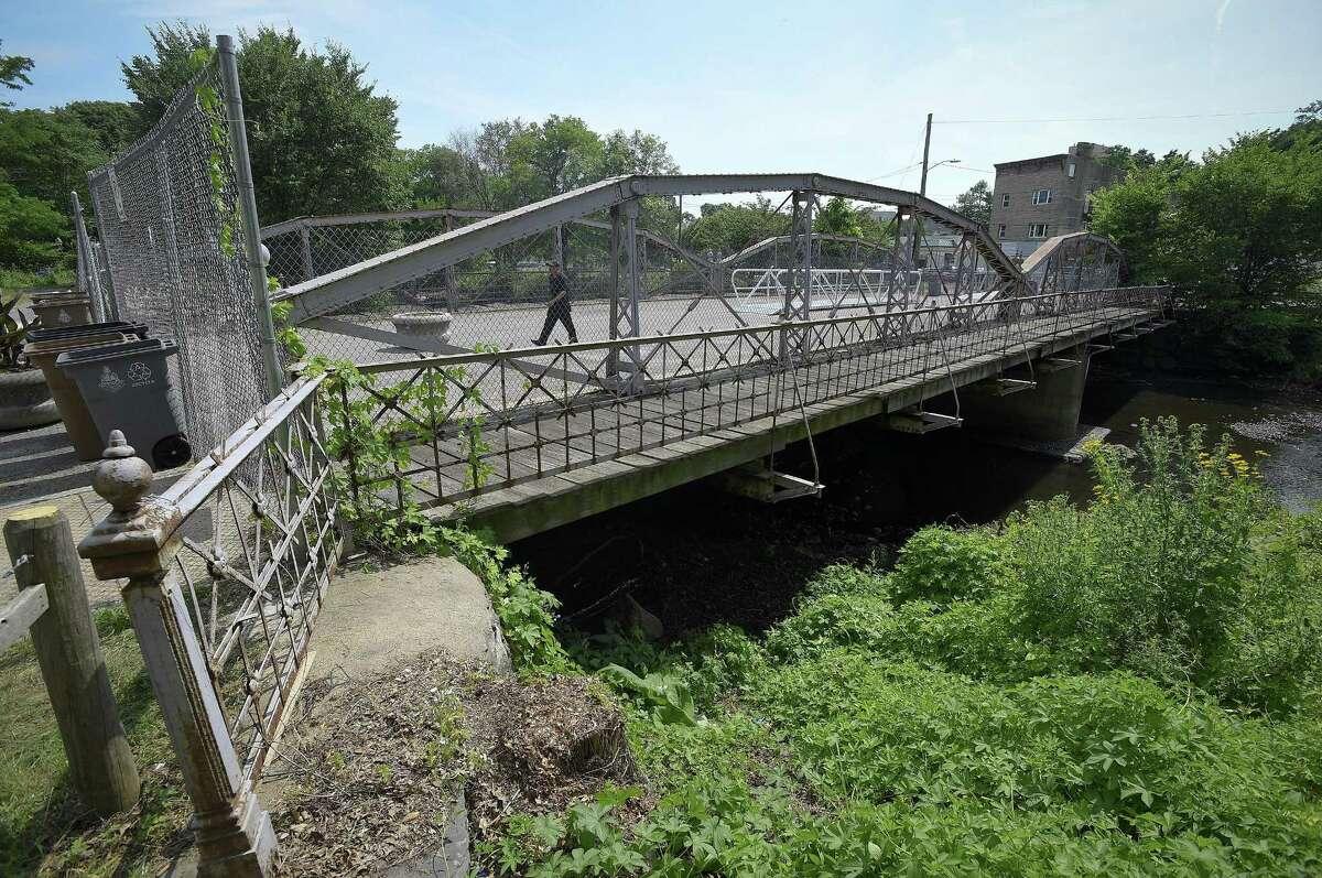 Pedestrians cross the West Main Street bridge near Mill River Street on July 13, 2018 in Stamford, Connecticut.