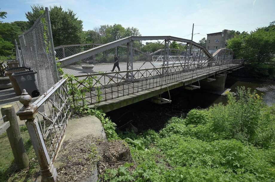 Pedestrians cross the West Main Street bridge near Mill River Street on July 13, 2018 in Stamford, Connecticut. Photo: Matthew Brown / Hearst Connecticut Media / Stamford Advocate