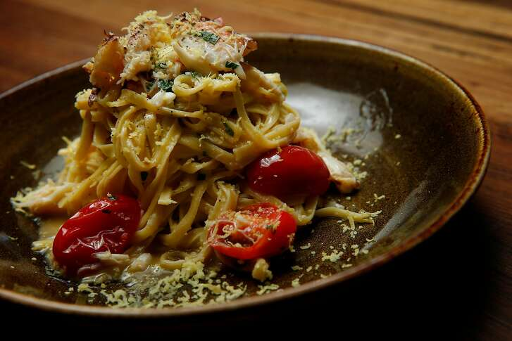 Linguine Granchio consisting of parsley-studded linguine, dungeness crab meat, lemon zest, tomatoes and olive oil at Pasta Pop Up, Thursday, April 12, 2018, in San Francisco, Calif. The Italian restaurant is located at 550 Green Street.