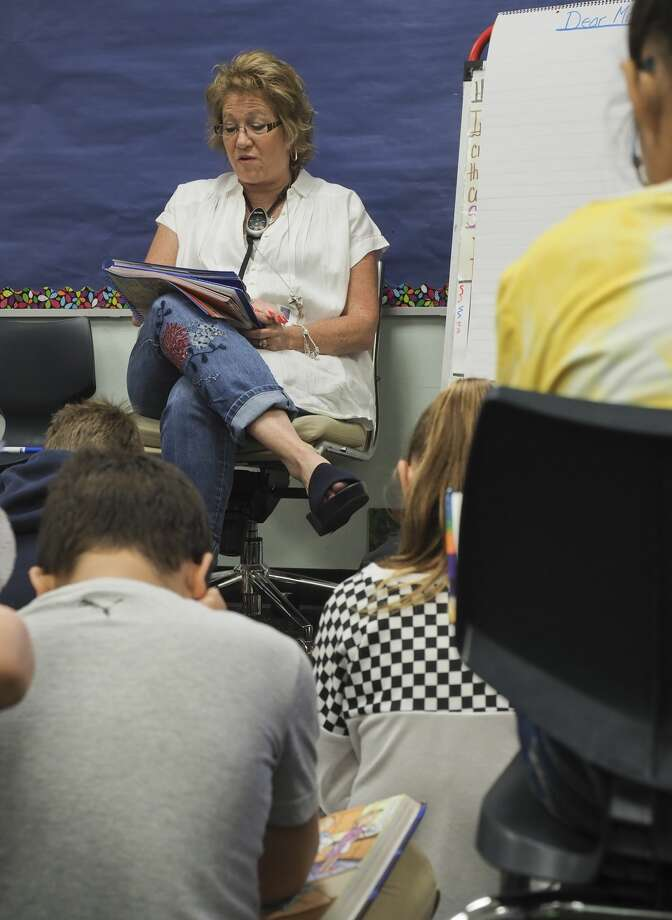 Emerson Elementary fourth grade teacher Amy Holmes reads with her students 08/24/18 morning. Tim Fischer/Reporter-Telegram Photo: Tim Fischer/Midland Reporter-Telegram