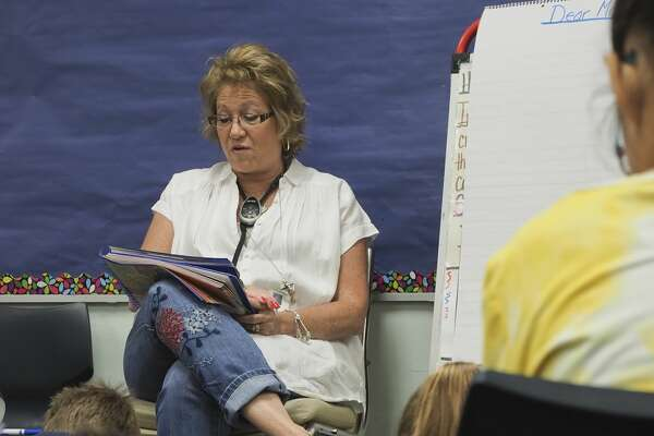 Emerson Elementary fourth grade teacher Amy Holmes reads with her students 08/24/18 morning. Tim Fischer/Reporter-Telegram