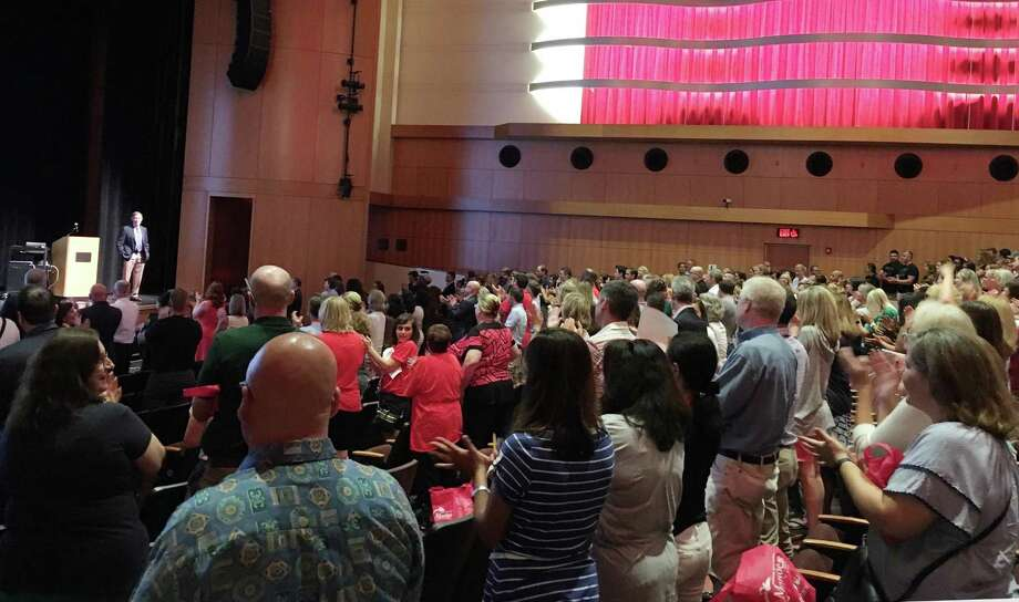 Greenwich Public School administrators and teachers give interim superintendent and Greenwich native Ralph Mayo a standing ovation at convocation, the districts annual back-to-school gathering for educators on Monday, Aug. 27, 2018. Mayo, who grew up in the Geeenwich public school system, charged attendees to rebuilt trust with members of the community. Photo: Jo Kroeker / Hearst Connecticut Media / Greenwich Time