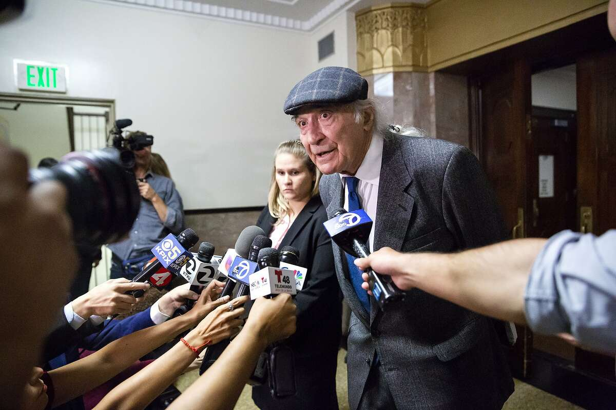 Tony Serra, Derick Almena's attorney, speaks to the press following the judge rejected the plea deals during the final day of the sentencing hearing of the Ghost Ship fire defendants Derick Almena and Max Harris in Oakland, Calif. on August 10, 2018.