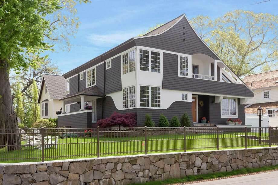 The four-bedroom was built in 1979 and completely renovated by Architect Roger Bartels in the 1990s. The home is listed for $1.675 million. Photo: Halstead Connecticut / ONLINE_CHECK