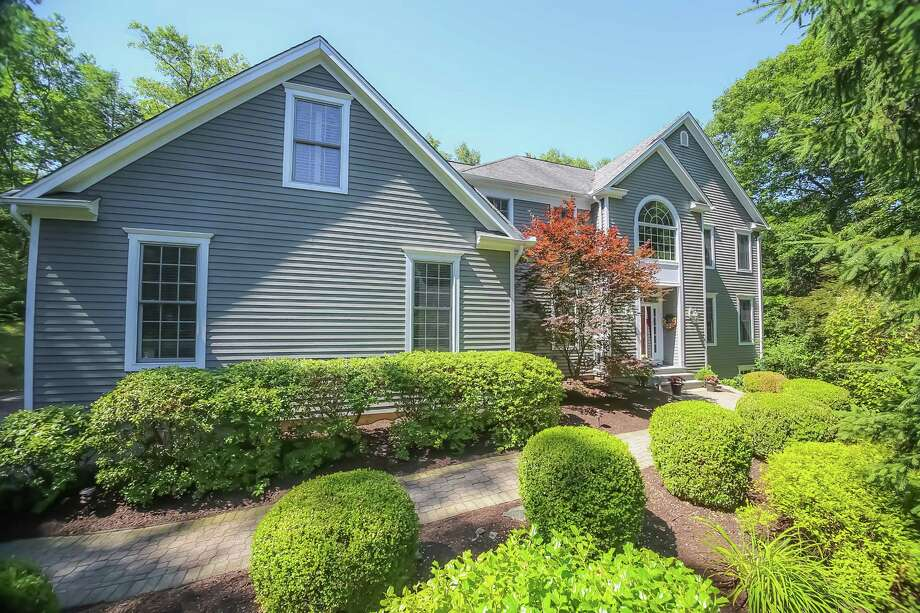 The four-bedroom is on 1.84 acres at 27 Obtuse Rocks Road in Brookfield. Photo: Berkshire Hathaway HomeServices New England Properties / ONLINE_CHECK