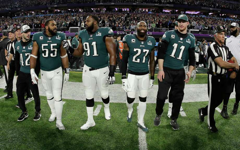 FILE - In this Feb. 4, 2018, file photo, Philadelphia Eagles' Chris Maragos, Brandon Graham, Fletcher Cox, Malcolm Jenkins and Carson Wentz, from left, walk to midfield before the NFL Super Bowl 52 football game against the New England Patriots in Minneapolis. Before they try to become the ninth team to repeat as Super Bowl champions, the Philadelphia Eagles will try to accomplish another tough task. Winning consecutive NFC East titles is so difficult it hasn't happened since the Eagles did it four straight seasons from 2001-04. (AP Photo/Matt Slocum, File) Photo: Matt Slocum / Copyright 2018 The Associated Press. All rights reserved.