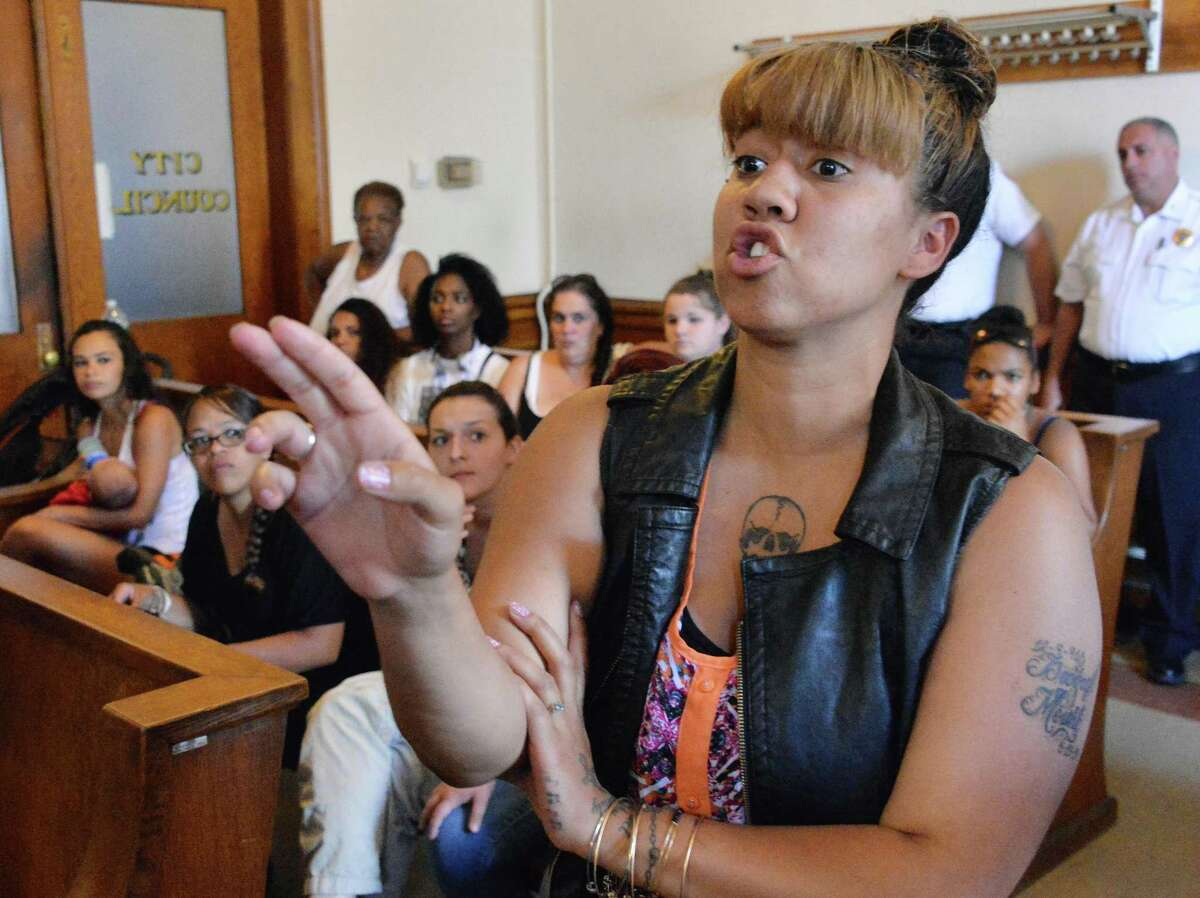 Miranda Mount of Ballston Spa asks questions of Saratoga Springs Public Safety Commissioner Chris Mathiesen relating to the death of her brother Darryl Mount Jr. Friday, June 20, 2014, during a news conference at City Hall in Saratoga Springs, NY. (John Carl D'Annibale / Times Union)