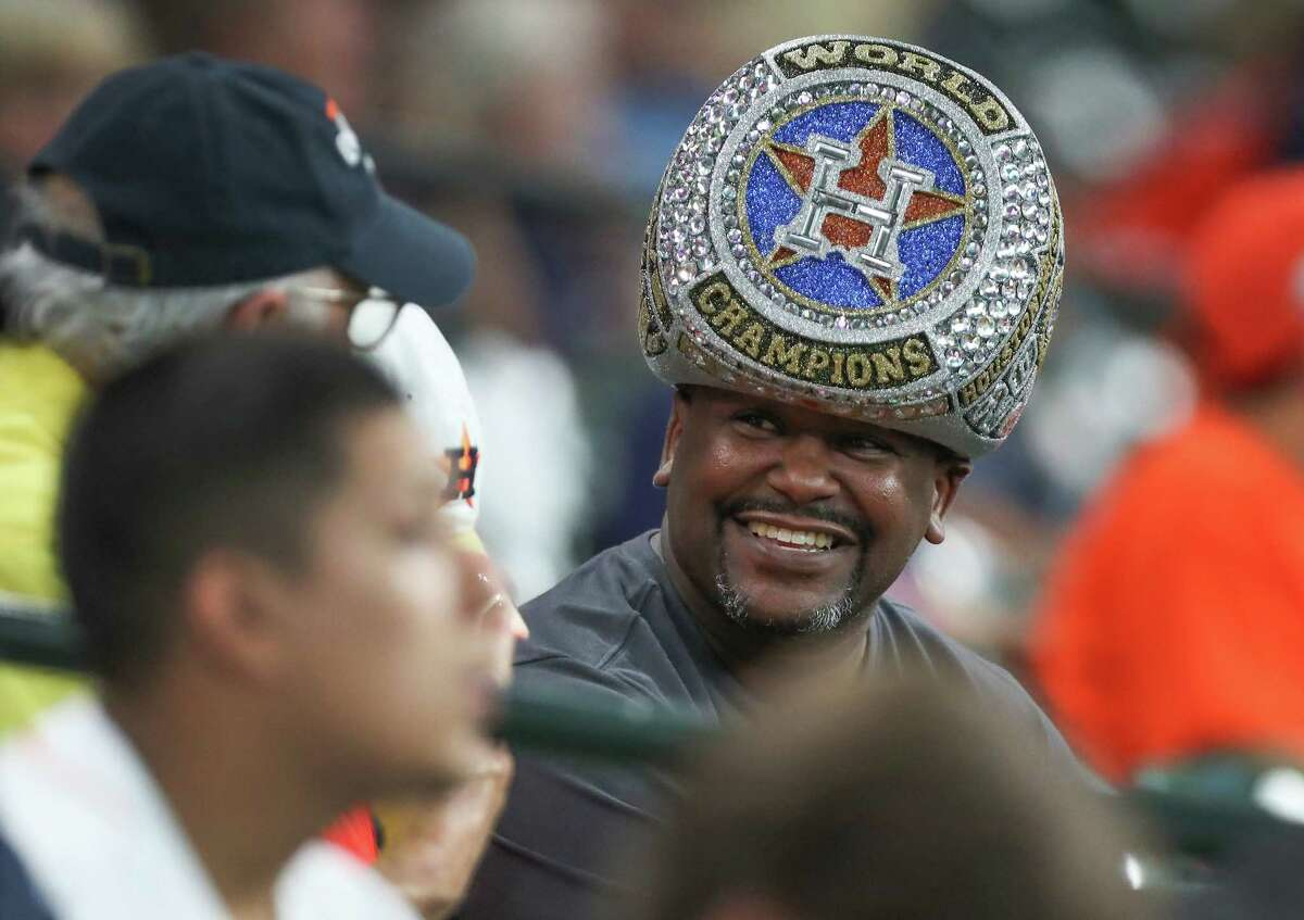 Astros fan Spencer Gauthier sports a World Series Championship Ring hat before the start of an MLB game at Minute Maid Park Monday, Aug. 27, 2018, in Houston.