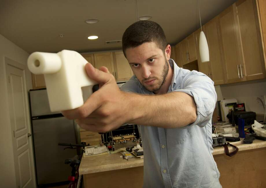 Cody Wilson shows the first completely 3D-printed handgun, The Liberator, at his home in Austin, Texas on Friday May 10, 2013.  Photo: Jay Janner / TNS