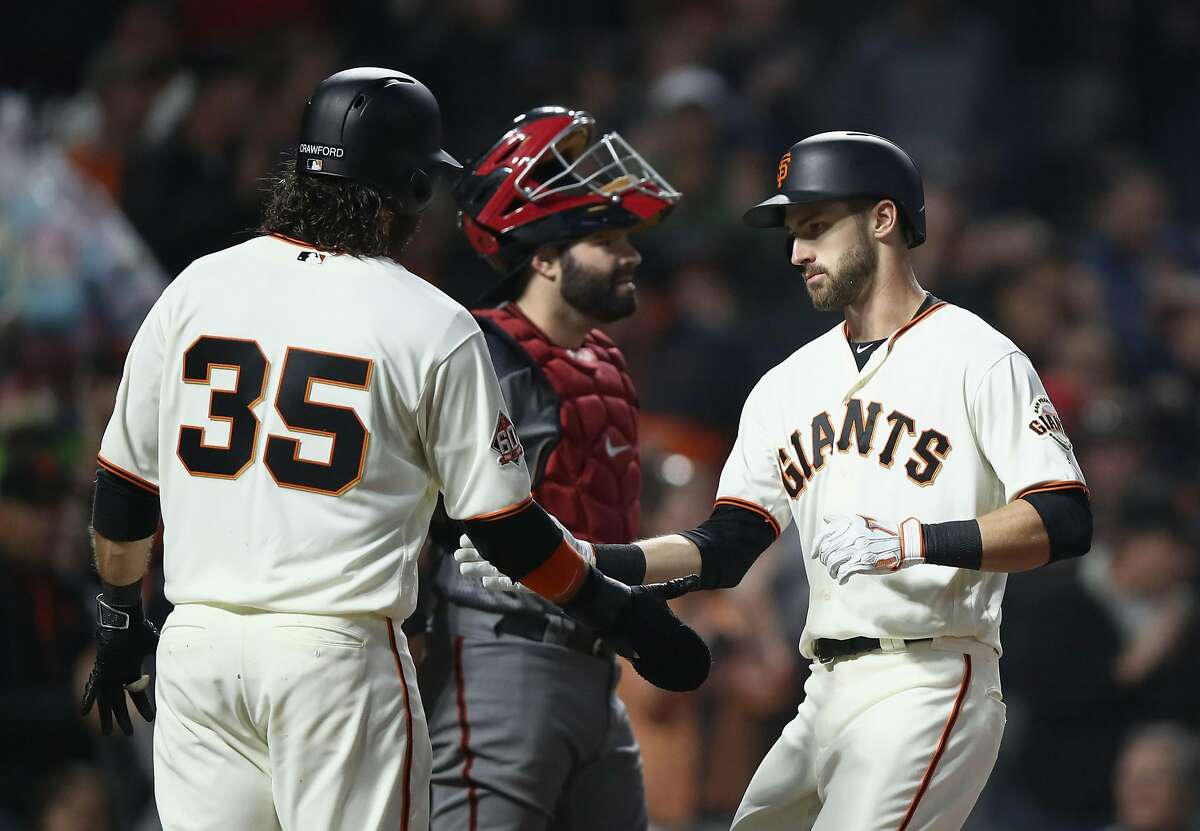 SAN FRANCISCO, CA - AUGUST 27: Steven Duggar #6 of the San Francisco Giants is congratulated by Brandon Crawford #35 after hitting a two-run home run in the second inning against the Arizona Diamondbacks at AT&T Park on August 27, 2018 in San Francisco, California. (Photo by Ezra Shaw/Getty Images)