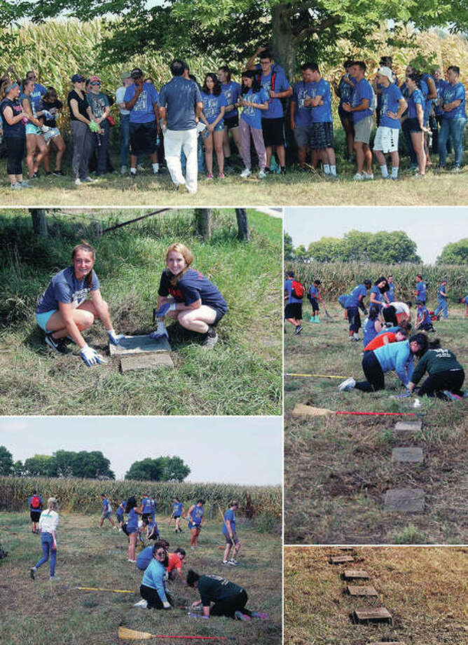 """Despite sweltering temperatures, students from MacMurray College and Illinois College spent about four hours Sunday cleaning up a burial ground associated with the Morgan County Poor House and Farm. Students cleared weeds and brush and returned headstones to their intended locations. The project stemmed from research that Joseph Squillace, MacMurray College associate professor of social work, conducted for his book, """"A History of the Poorhouse and Farm in Morgan County, Illinois."""" The plot had been set aside for those who did not have families or could not afford a burial plot in one of the other cemeteries. Volunteers cleared about a half-acre of waist-high weeds and scrub trees. Squillace also spent time discussing the history of the Poor House and Farm and shared information about some of those buried there."""