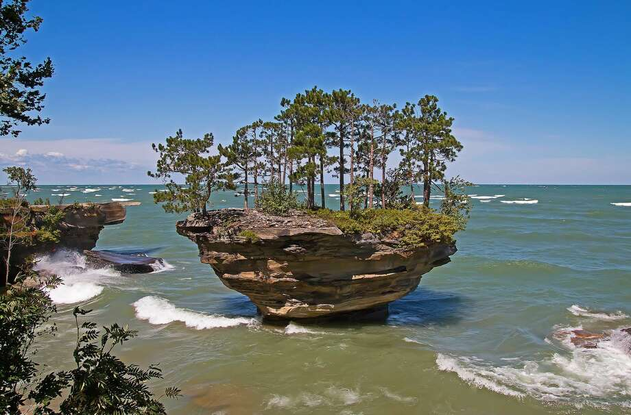 High winds recently created some wave action around Turnip Rock. Photo: Bill Diller/For The Tribune