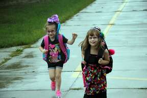 The weather was dreary but spirits were high, Tuesday morning, at the first day of school for Bad Axe Elementary students.