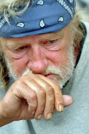 Poppy's friend Tom, a homeless man, on Thursday, July 16, 2009, on Pearl Street in Albany, N.Y. (Cindy Schultz / Times Union) Photo: CINDY SCHULTZ