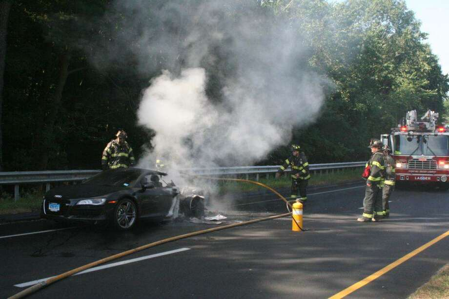 Fire officials are investigating the cause of an early morning car fire on the Merritt Parkway that destroyed an Audi  R8 belonging to a Connecticut Powerball winner. Photo: Scott R. Bisson/Contributed Photo, Contributed Photo / Connecticut Post