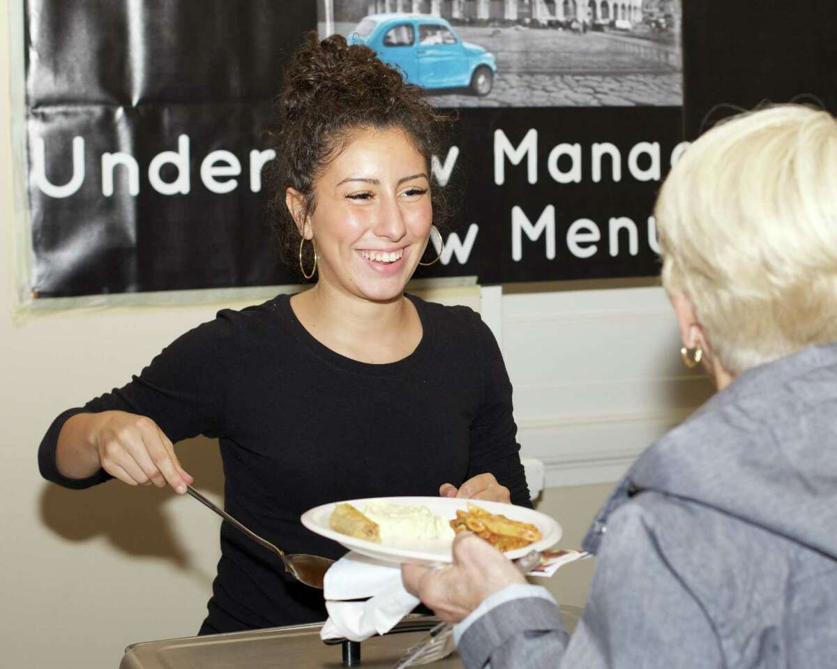Isabella Pizzo of Colosseo Bar Ristorante and Pizza serves samples of the restaurant's menu at the 2017 Taste of New Milford.