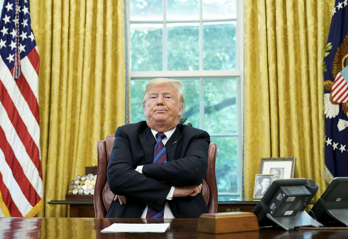 """(FILES) In this file photo taken on August 27, 2018 US President Donald Trump speaks to reporters after a phone conversation with Mexico's President Enrique Pena Nieto on trade in the Oval Office of the White House in Washington, DC. - US President Donald Trump claimed August 28, 2018 that Google results were """"rigged"""" because searches for """"Trump News"""" brought up negative stories about him, and questioned whether this was illegal. The president has attacked US social media giants in the past days for allegedly censoring conservative voices, an unfounded claim widely believed by his followers.""""Google search results for 'Trump News' shows only the viewing/reporting of Fake New Media,"""" the president tweeted on Tuesday. (Photo by MANDEL NGAN / AFP)MANDEL NGAN/AFP/Getty Images"""