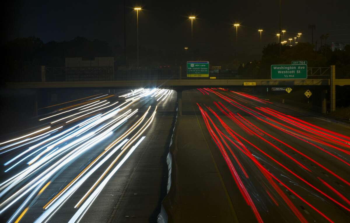 Motorists drive on eastbound and westbound lanes of Interstate 10 near Durham Drive.