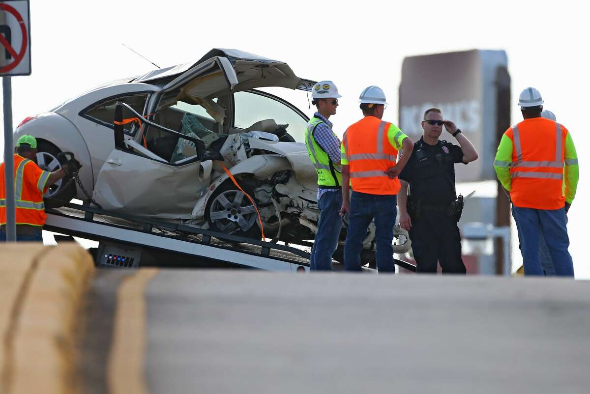 Authorities investigate the scene of single-vehicle crash, where two people died, on the Interstate 69 HOV off-ramp near Townsen Boulevard Tuesday, June 12, 2018, in Humble, Texas.