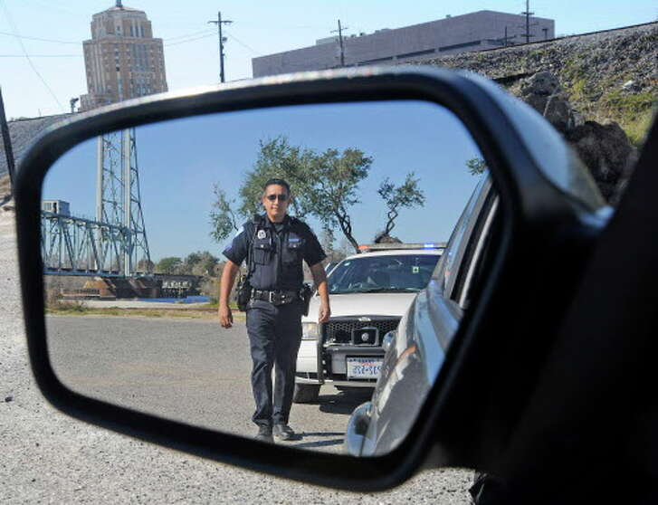 When stopped by a law enforcement official, they can been seen walking up to the driver through the side view mirror. Police Officers like Beaumont Police Sgt. Rob Flores, are trained to approach a vehicle a certain way. In the past year, four Southeast Texans have tried pretending to be a police officer, firefighter, EMS/sheriff's deputy and even an ATF official. If you get caught, the charge of impersonating an officer of the law is a felony.  Dave Ryan/The Enterprise