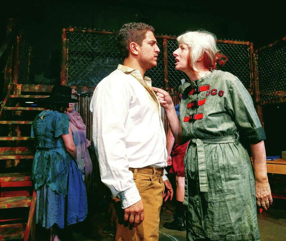 "Penny, played by Elyse Jasensky, makes sure that Bobby, played by Chris Balestriere, knows his rightful place at Amenity #9, in The Ridgefield Theater Barn's production of ""Urinetown, The Musical,"" Sept. 6-28 Photo: Paulette Layton / Contributed Photo"