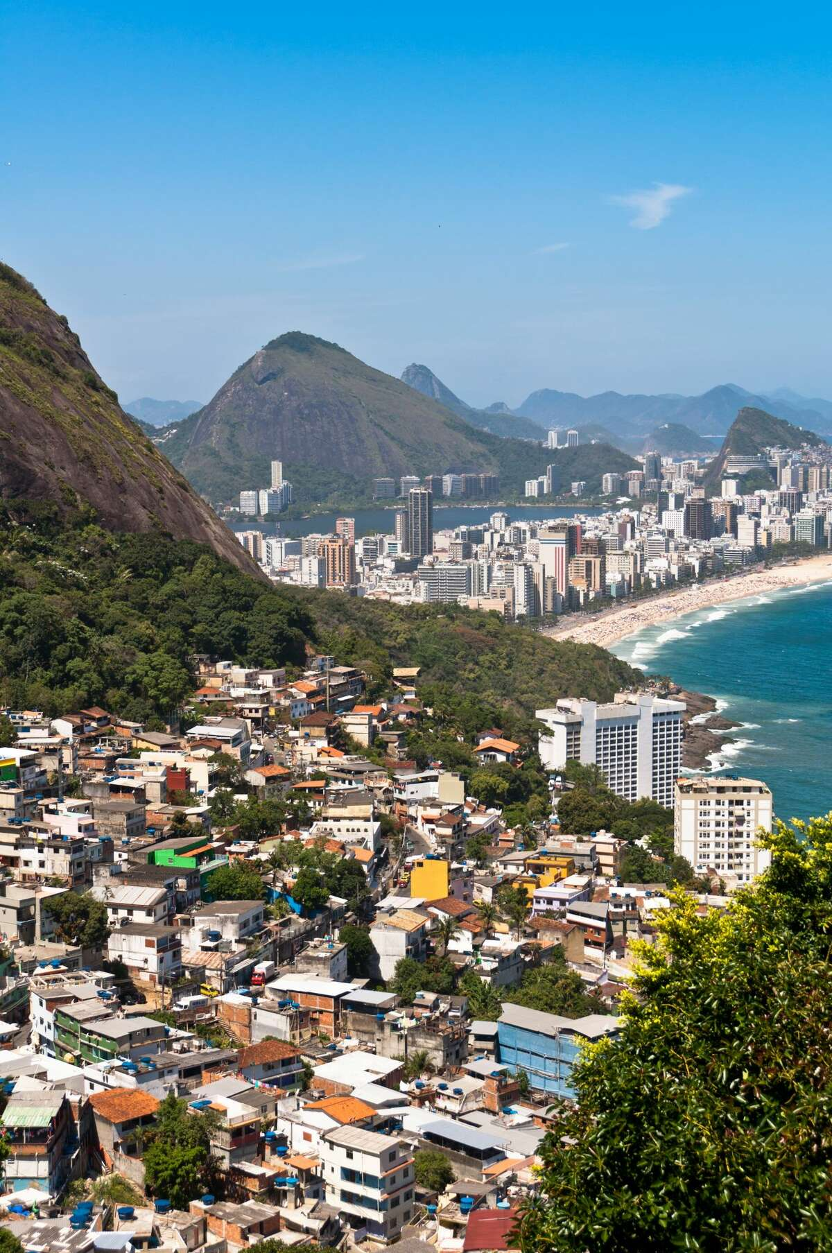 """In """"Bunker Bay Area,"""" """"manicured, highly protected neighborhoods are surrounded by slums."""" This is a situation similar to that in Latin American cities, """"where the poorest and the richest inhabit distinct worlds right on top of one another."""" Above is an aerial view of Ipanema and Leblon Beach and Vidigal Favela, Rio de Janeiro, Brazil."""