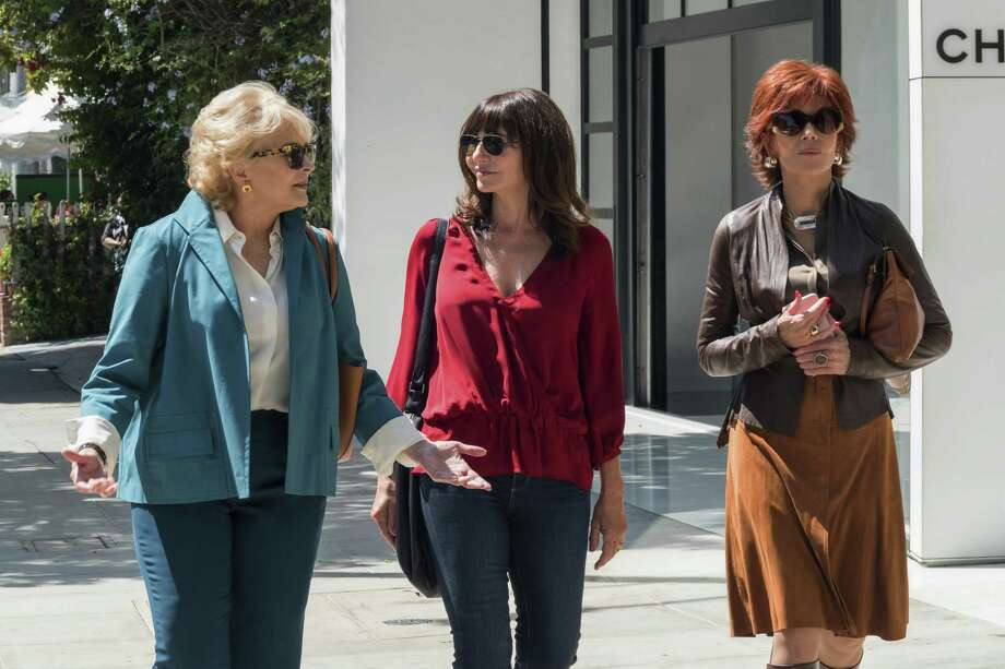 "Candice Bergen (left), Mary Steenburgen and Jane Fonda catch up on their reading in a scene from ""Book Club."" Photo: Paramount Pictures / © 2018 PARAMOUNT PICTURES. ALL RIGHTS RESERVED."