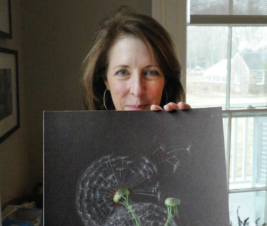 Botanical artist Jeanne Reiner poses with her drawing of a Dandelion seed stem. Photo: Bob Luckey Jr. / Hearst Connecticut Media / Greenwich Time