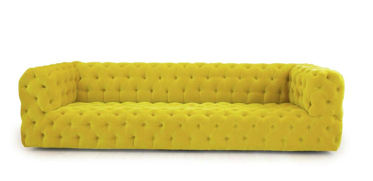 A yellow tufted sofa to anchor a fashionable living room. The Tailored Home in Westport has opened a second shop in Greenwich.