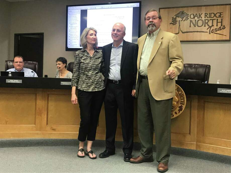 The Oak Ridge North City Council named Richard Derr, center, as the new city manager on Monday night. Derr posed with his wife Elizabeth and Mayor Jim Kuykendall. Photo: Photographed By Marialuisa Rincon