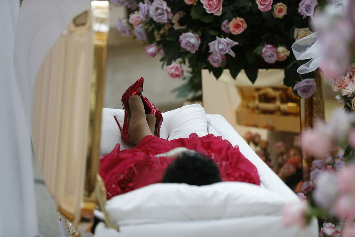 Aretha Franklin lies in her casket at Charles H. Wright Museum of African American History during a public visitation in Detroit, Tuesday, Aug. 28, 2018. Franklin died Aug. 16, of pancreatic cancer at the age of 76. (AP Photo/Paul Sancya, Pool)