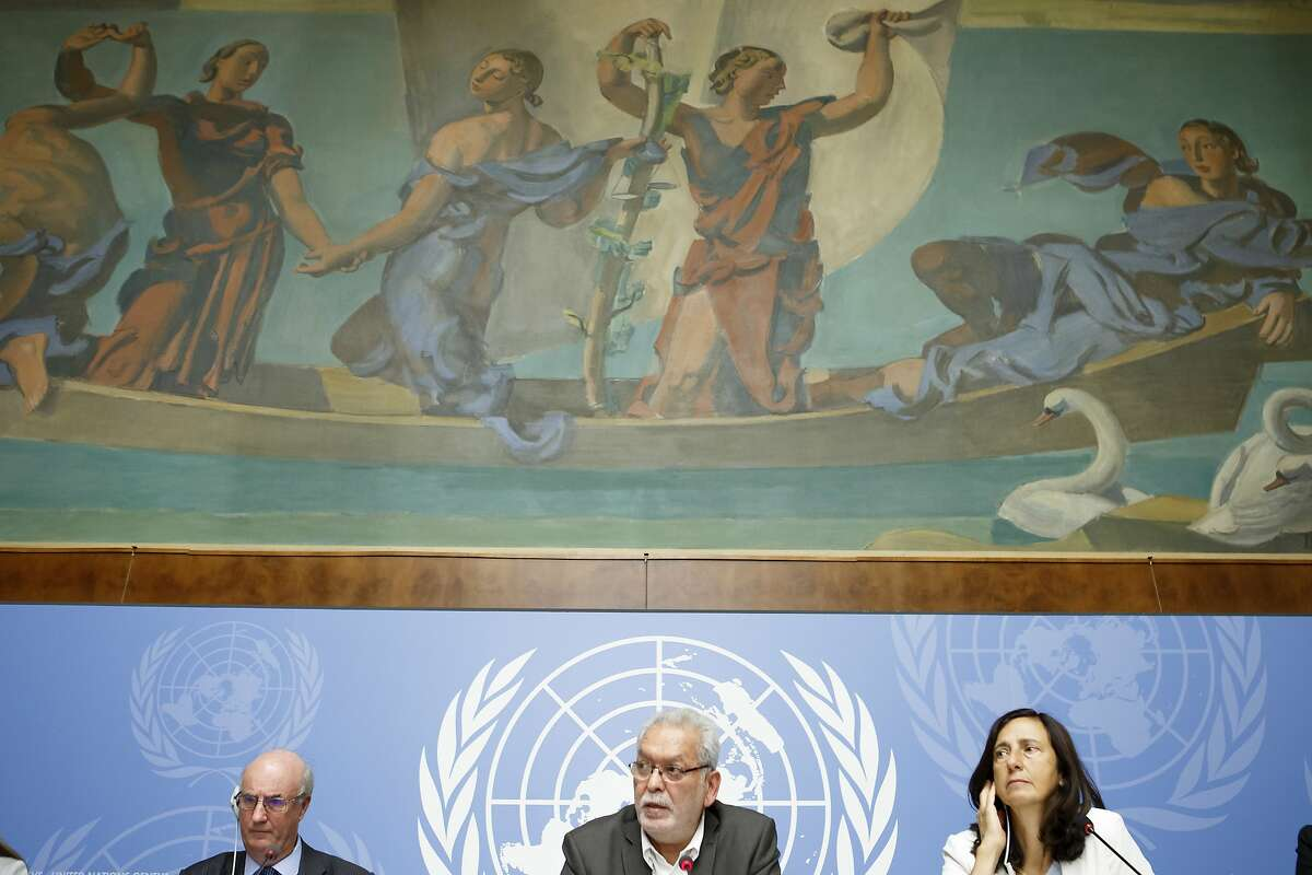 Kamel Jendoubi, centre, Chairperson of the Group of Eminent Experts on Yemen, is flanked by Charles Garraway, left, member of the Group of Eminent Experts on Yemen, and Alessandra Vellucci, right, Director of UN Information Service to Geneva, as they inform on the publication of its report on the establishment of facts and circumstances surrounding alleged violations and abuses committed by all parties to the conflict in Yemen, during a press conference, at the European headquarters of the United Nations in Geneva,, Switzerland, Tuesday, Aug. 28, 2018. (Salvatore Di Nolfi/Keystone via AP)
