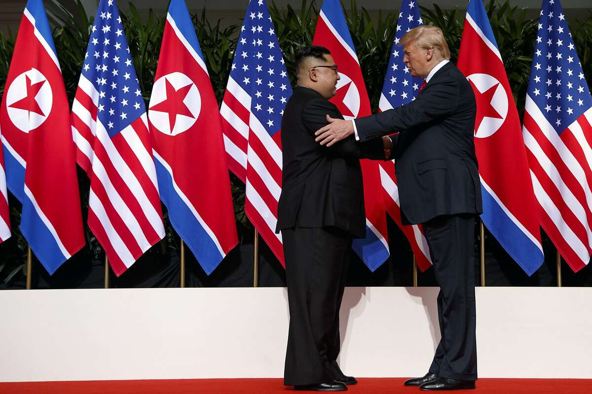FILE - In this June 12, 2018, file photo, President Donald Trump meets with North Korean leader Kim Jong Un on Sentosa Island, in Singapore. Japan's annual defense review says North Korea poses a serious threat to Japan since it hasn't taken concrete steps to scrap its nuclear program after making a denuclearization pledge at a summit with the U.S. in June. The defense paper approved Tuesday, Aug. 28, 2018, by the Cabinet said Japan must add costly missile defense systems to be fully prepared while watching if North Korea keeps its promise. (AP Photo/Evan Vucci, File )