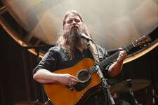 """FILE - In this Aug. 22, 2018, file photo, Chris Stapleton performs at the 12th Annual ACM Honors at the Ryman Auditorium in Nashville, Tenn. Stapleton tops the list of finalists with five nominations for the 52nd annual Country Music Association Awards. The nominations were announced Tuesday, Aug. 28, from entertainer Luke Bryan's restaurant and bar in Nashville on ABC's """"Good Morning America."""" (Photo by Al Wagner/Invision/AP, File)"""