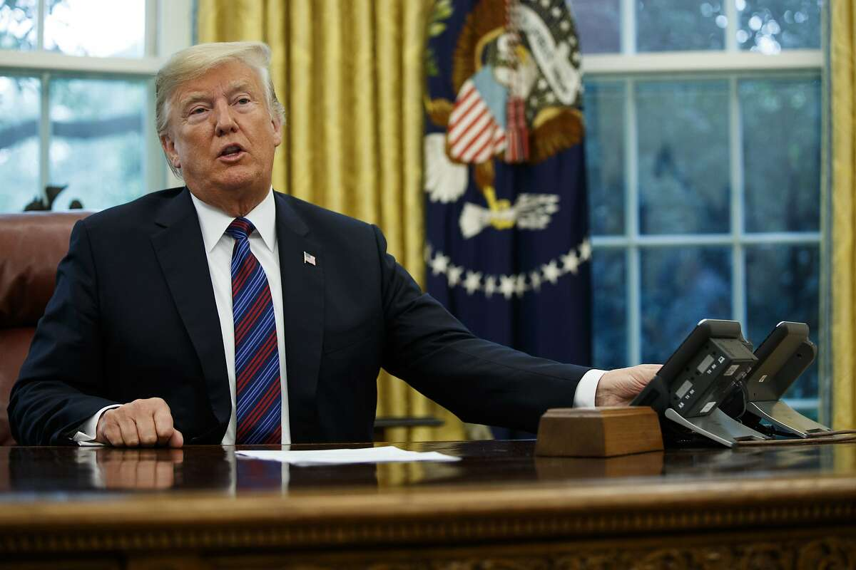 President Donald Trump talks on the phone with Mexican President Enrique Pena Nieto, in the Oval Office of the White House, Monday, Aug. 27, 2018, in Washington. (AP Photo/Evan Vucci)