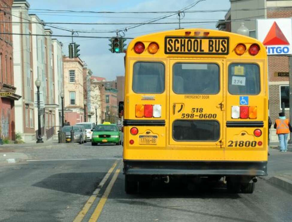 An Albany school bus makes its rounds. Buses will once again be a common sight starting Sept. 6 when the new school year begins.