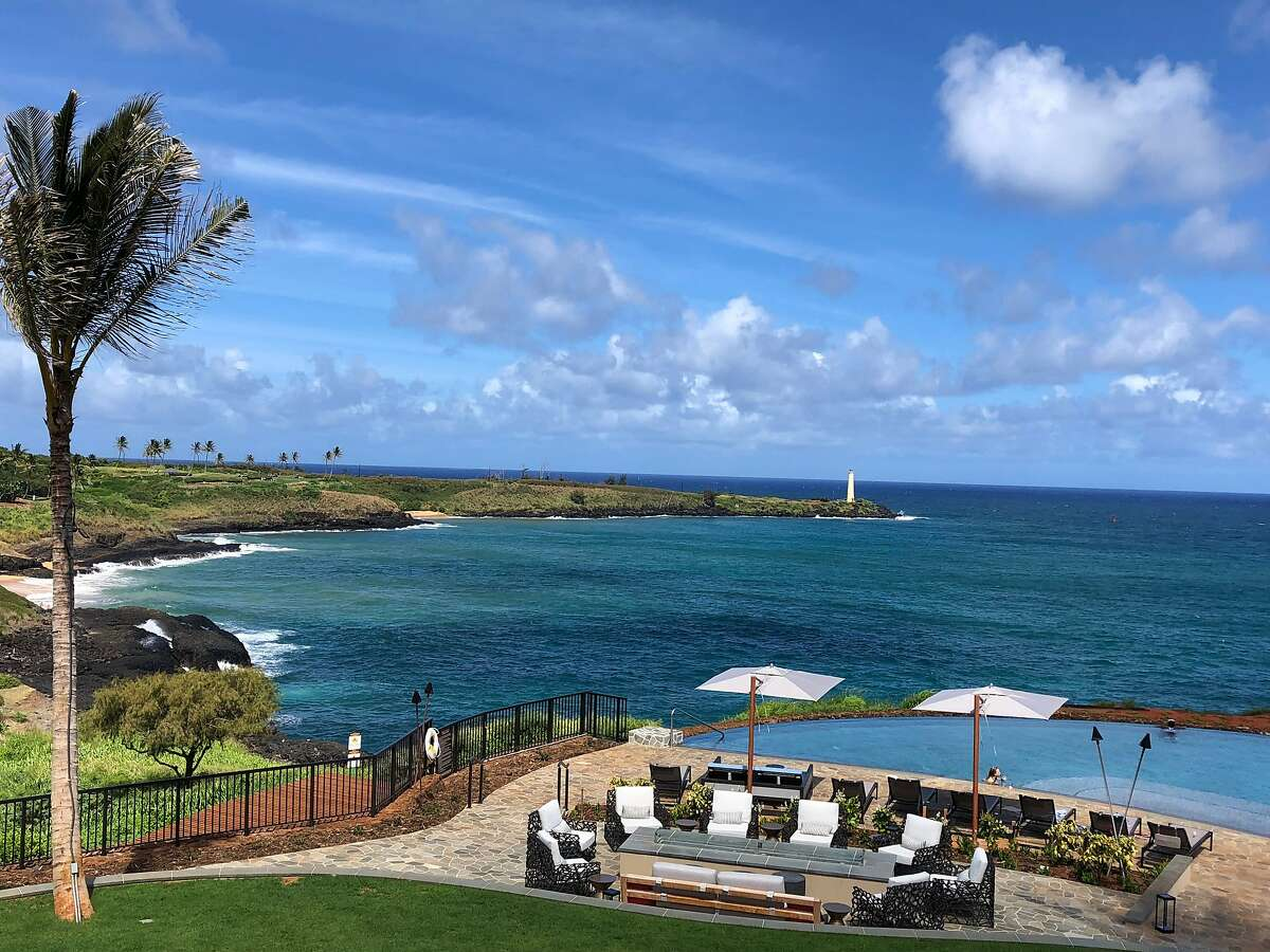 The new Timbers Kauai Ocean Resort and Residences at Hokuala offers views of the lighthouse at Ninini Point.