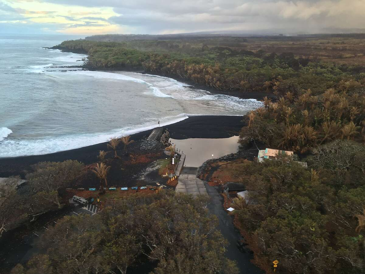 Although not yet accessible to the public, a new black sand beach has formed around the boat landing in Isaac Hale Beach Park in Pohoiki on Hawaii Island.