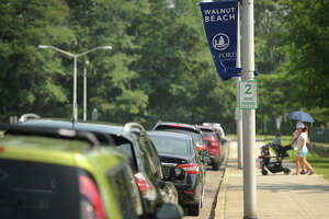 Free two hour on street parking on East Broadway outside the entrance to Walnut Beach in Milford, Conn. on Tuesday, August 28, 2018. Public beaches in Milford charge 15 dollars a day for out of town resident parking, but free on street parking is available in many beach areas.