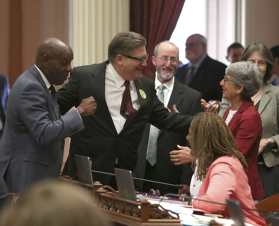 State Sen. Bob Hertzberg, D-Van Nuys, second from left, receives congratulations from fellow Democratic state Sens. Steven Bradford of Los Angeles, left, Steve Glazer, of Orinda, third from left, and Hannah-Beth Jackson of Santa Barbara, right, after his bail reform bill was approved by the state Senate on Aug. 21. Photo: Rich Pedroncelli / Associated Press